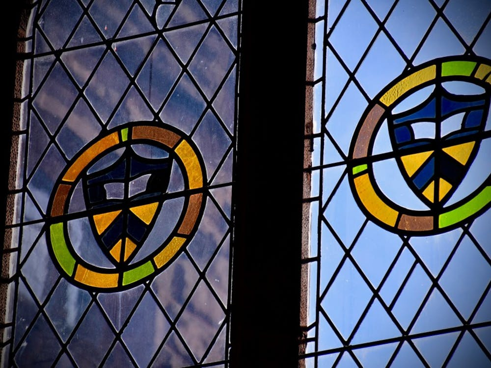 Sunlight streams through stained glass windows in East Pyne Hall. Jon Ort / The Daily Princetonian
