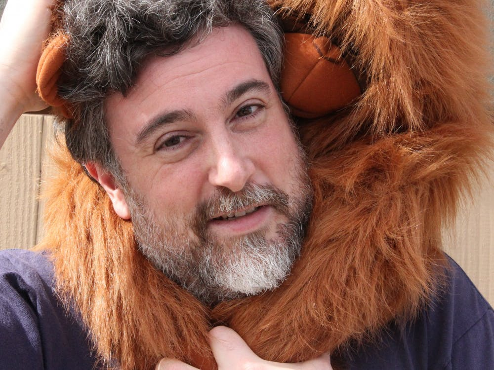 Professor Graziano and his orangutan puppet Kevin. Courtesy of Michael Graziano.