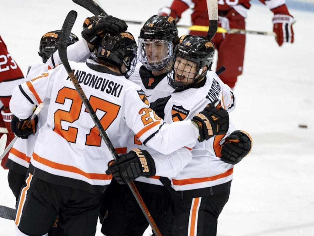 Princeton celebrates after scoring a goal against Harvard