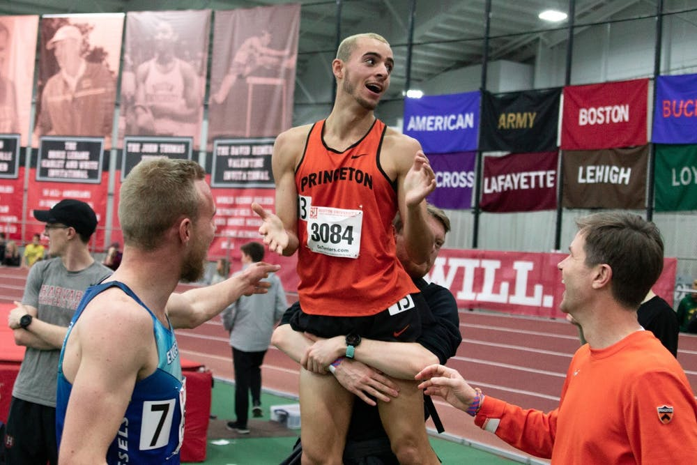 <h5>Sam Ellis '22 celebrating in Boston in Feb. 2019 after breaking four minutes in the mile race.</h5> <h6>Courtesy of Sam Ellis</h6>