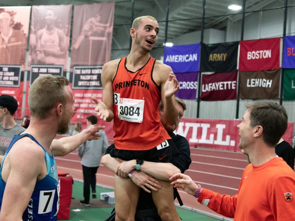 Sam Ellis '22 celebrating in Boston in Feb. 2019 after breaking four minutes in the mile race. Courtesy of Sam Ellis