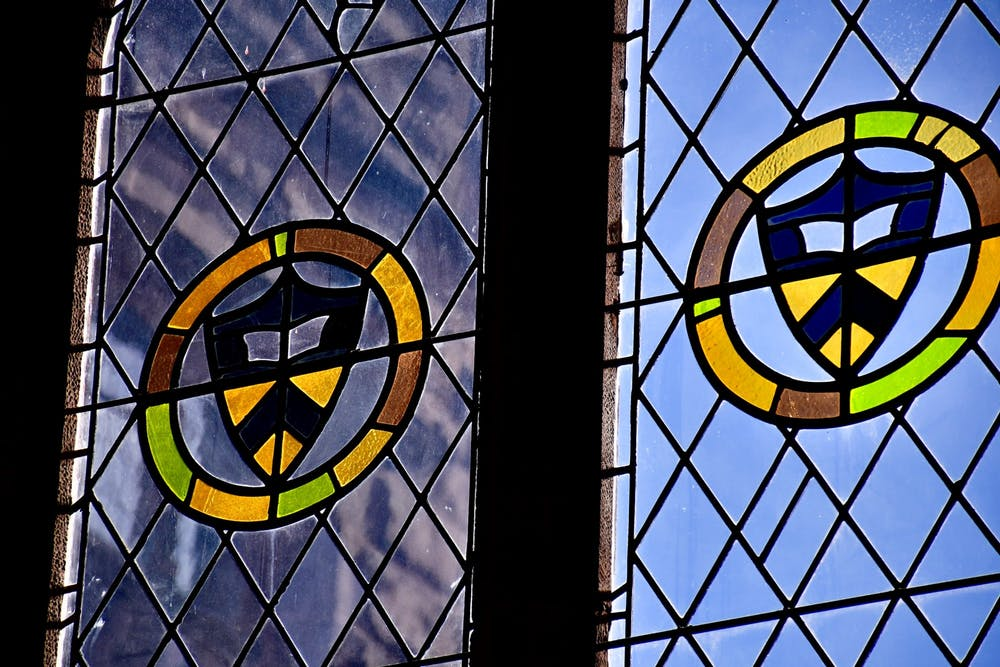 <h5>Stained glass windows in East Pyne Hall.</h5> <h6>Jon Ort / The Daily Princetonian</h6>