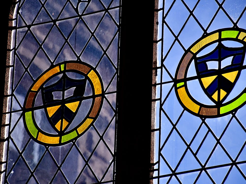 Stained glass windows in East Pyne Hall. Jon Ort / The Daily Princetonian