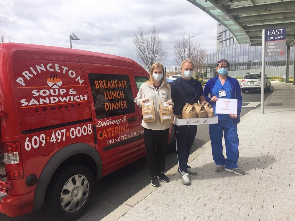 Alex Ruddy (left) and her father (center), delivering 90 bagged lunches to the Princeton Medical Center. Courtesy of Alex Ruddy