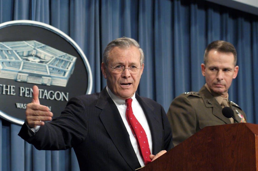 "<p>Donald Rumsfeld '54 at a Pentagon press conference on Dec. 16, 2003.</p> <h6>Photo Courtesy of Department of Defense <a href=""https://archive.defense.gov/photos/newsphoto.aspx?newsphotoid=4872"" target=""_self"">Press Operations</a></h6> <p>&nbsp;&nbsp;</p>"