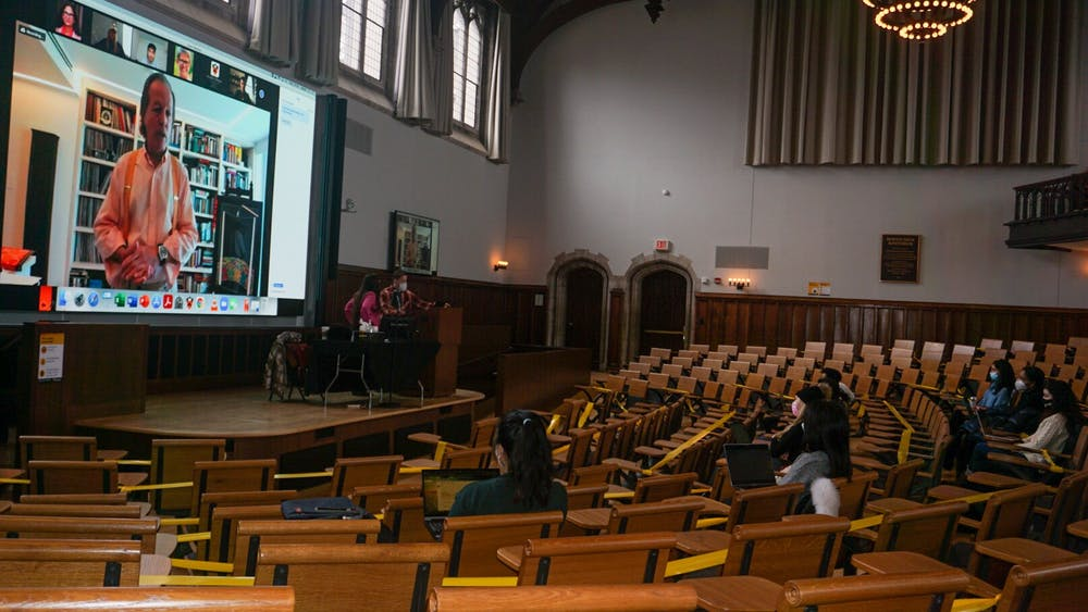 Students in McCosh 50 while Professor David Miller teaches on Zoom John Raulston Graham / The Daily Princetonian