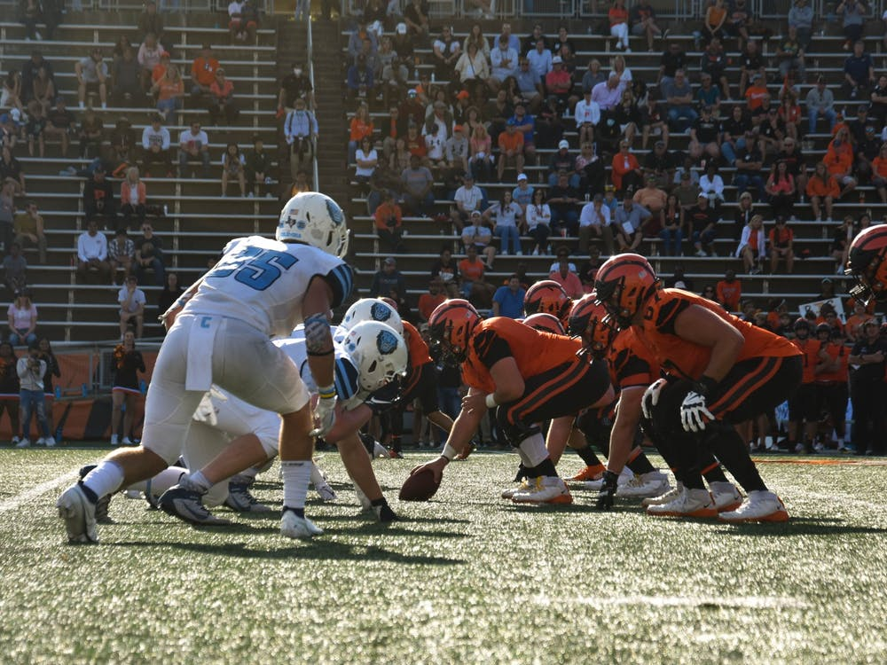 Tigers and Lions face off during a fourth-quarter drive that ended in Princeton's third touchdown of the game. Mark Dodici / The Daily Princetonian
