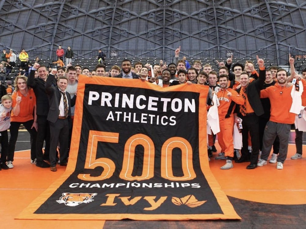 Princeton wresting holding the 500 Ivy League Championships banner after their Ivy League Championship against Cornell. Photo Courtesy of @princetonathletics Instagram account