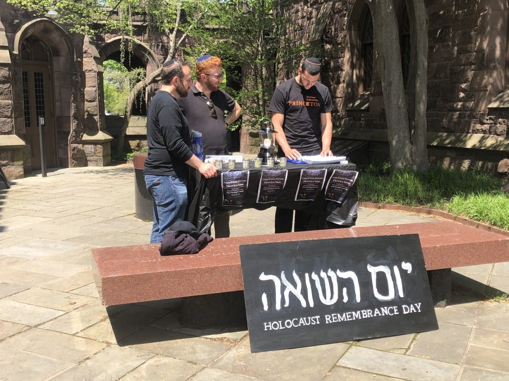 Students read the names of Holocaust victims outside of Murray-Dodge. Photo Credit: Taylor Sharbel / The Daily Princetonian