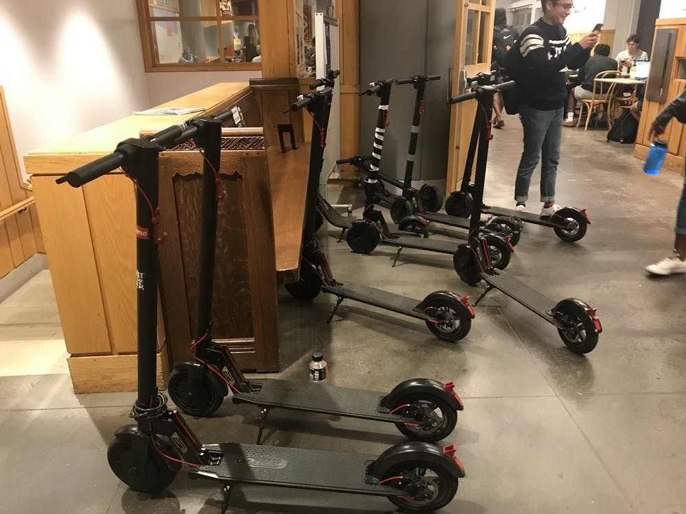 <p>A row of electric scooters parked indoors, on the A-level floor of Frist Campus Center.</p> <h6>Photo Credit: Zack Shevin / The Daily Princetonian&nbsp;</h6>