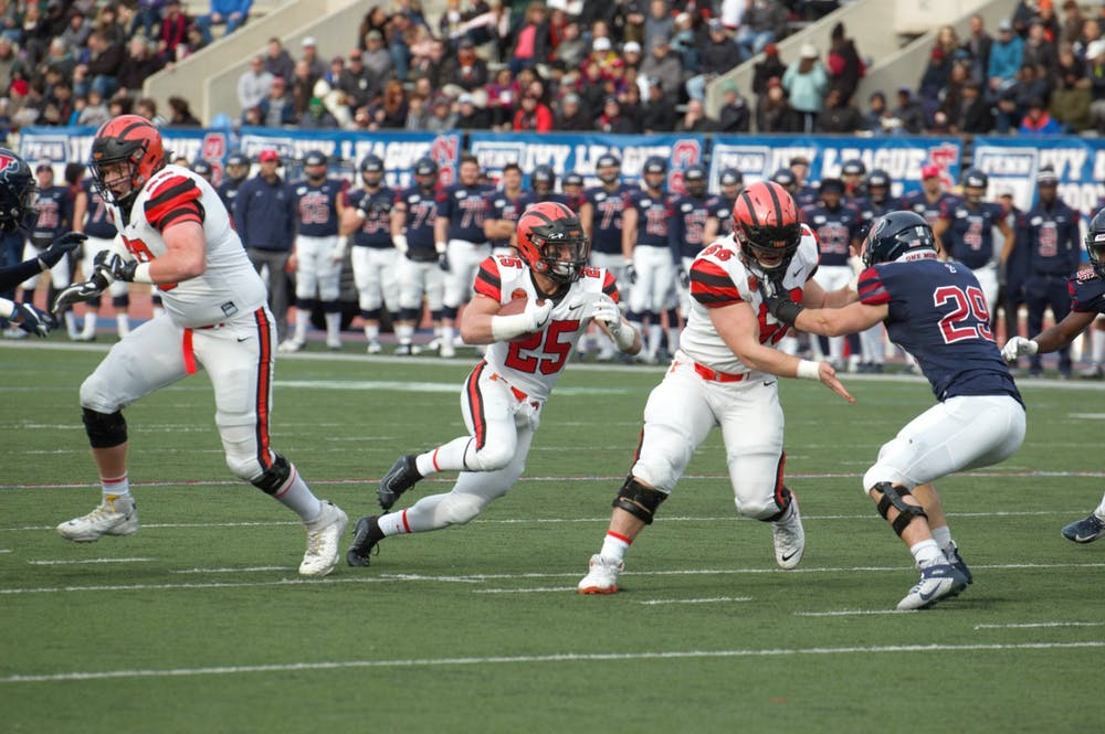 <p>Ryan Quigley rushes in the first half against Penn.</p> <h6>Photo Credit: Jack Graham / The Daily Princetonian</h6>