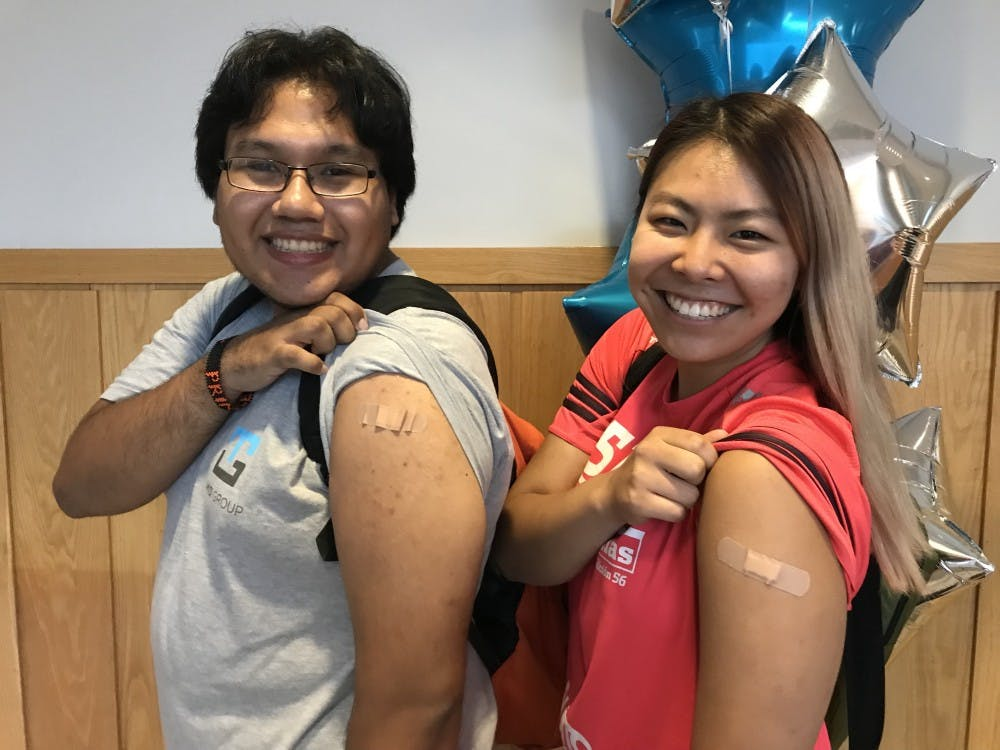 Rafael Tafur '20 and Phoebe Park '21 received flu vaccines from the annual vaccine clinic on Thursday, Oct. 4 in the basement of the Frist Campus Center.