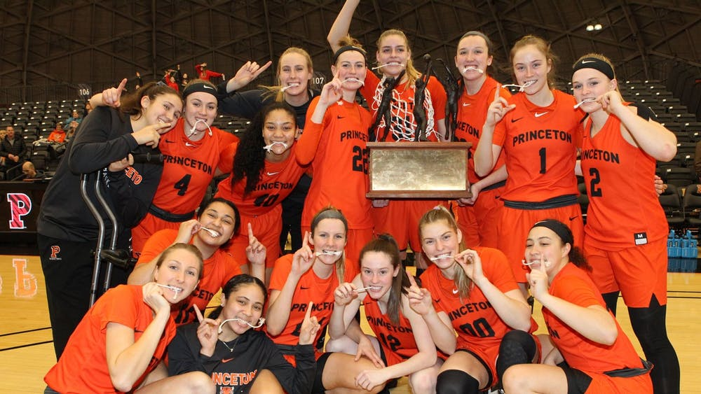 <p>Women's basketball team celebrates their Yale win with trophy and pieces of the net.</p> <h6>Photo courtesy of Beverly Schaefer / GoPrincetonTigers.com</h6>