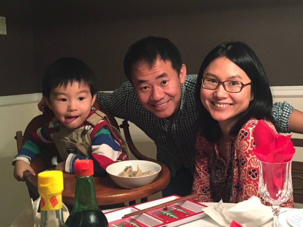 Fourth-year history graduate student Xiyue Wang with his wife Hua Qu and their now six-year-old son. Photo Credit: the Office of Communications