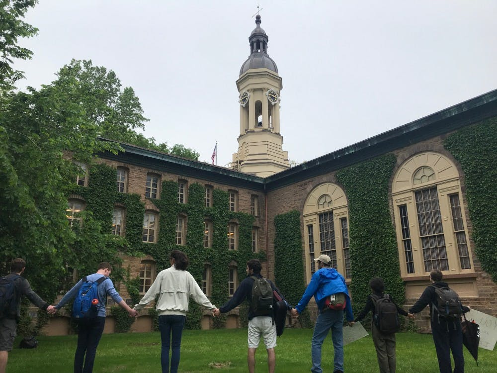 <h5>Students protesting the University's Title IX policy in May 2019 form a circle around Nassau Hall.</h5> <h6>Claire Silberman / The Daily Princetonian</h6>