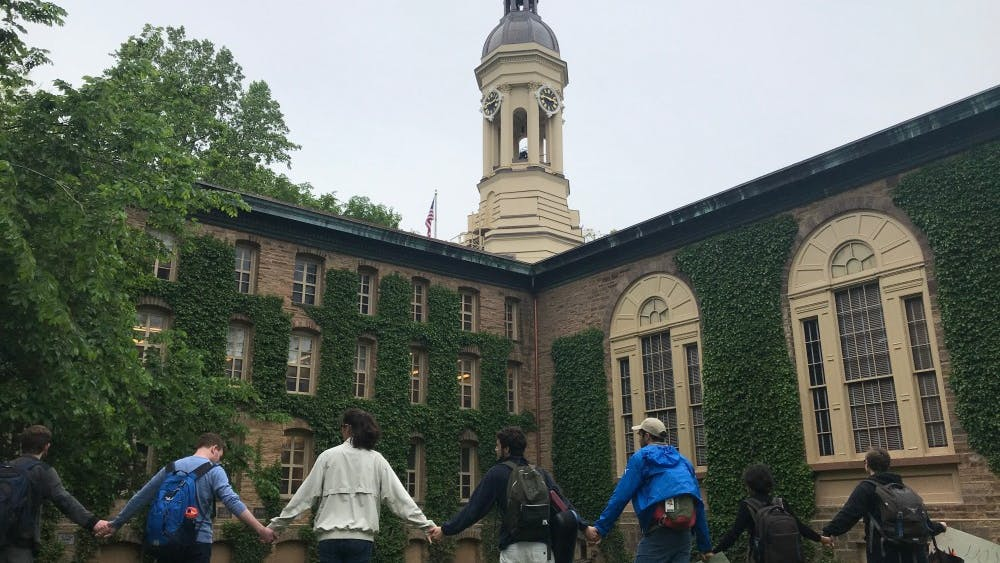 Students protesting the University's Title IX policy in May 2019 form a circle around Nassau Hall. Claire Silberman / The Daily Princetonian