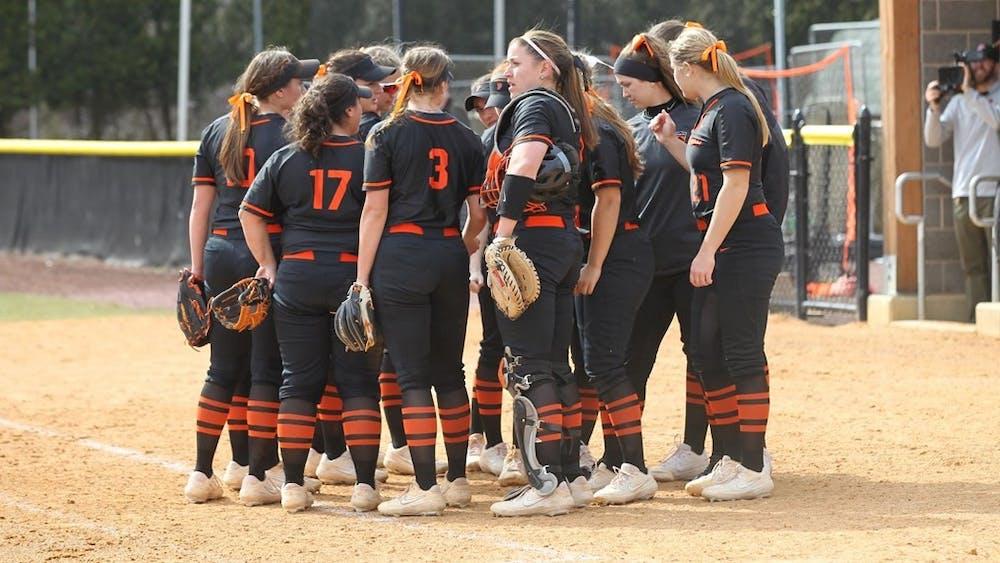 Women's softball, strategizing. Photo credit: Beverly Schaefer, GoPrincetonTigers.