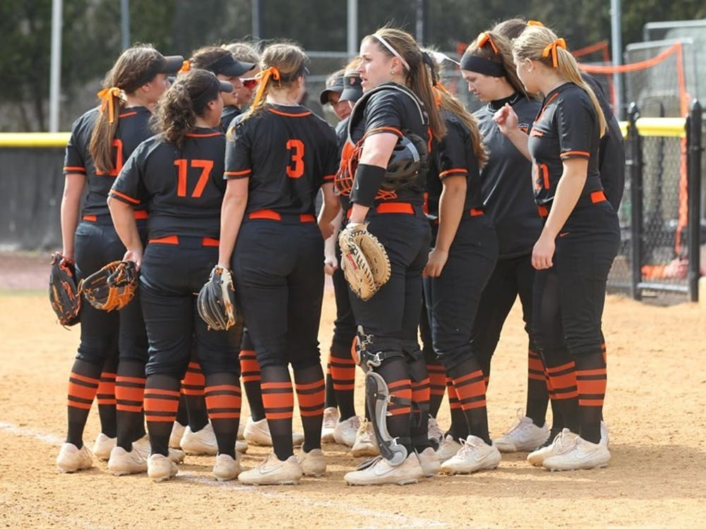 Women's softball, strategizing. Photo credit: Beverly Schaefer, GoPrincetonTigers.