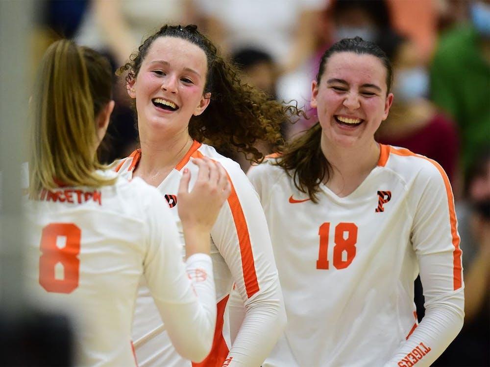 Elena Montgomery (middle) had 18 kills in the season sweep against Penn. Photo via GoPrincetonTigers.com