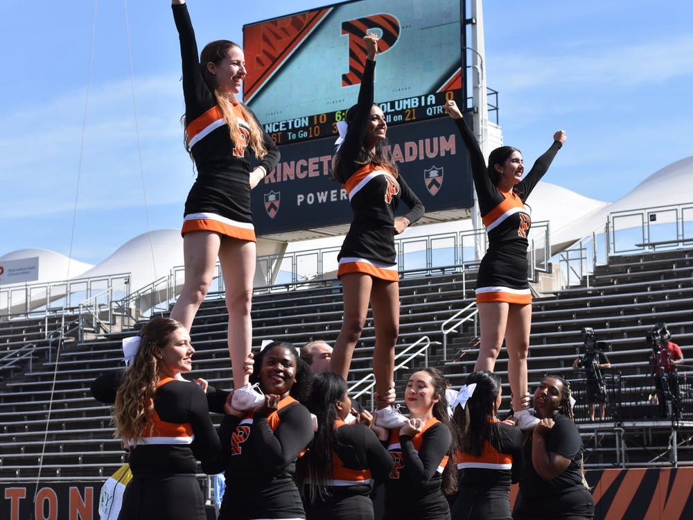 The Princeton cheerleading team performs on the sidelines at the Ivy League opener against Columbia. Angel Kuo / The Daily Princetonian
