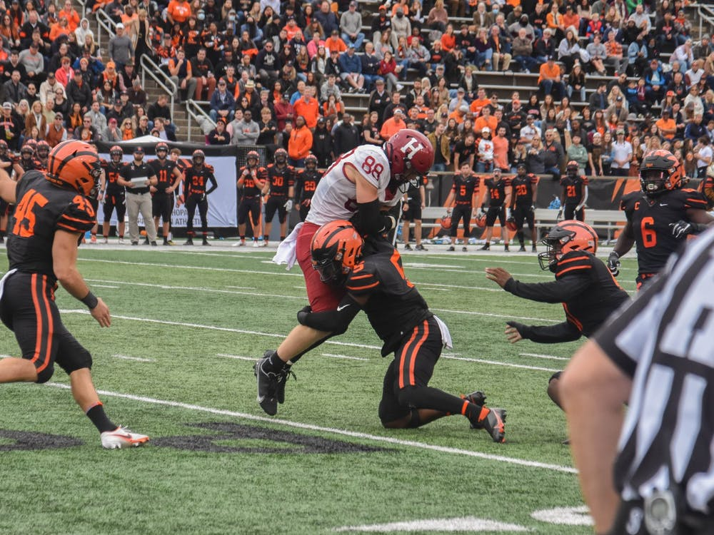 Powers Field was raucous, with total attendance over 10,000, as the Tigers outlasted the Crimson in a defensive battle that saw the referees play a rather conspicuous role. Mark Dodici / The Daily Princetonian