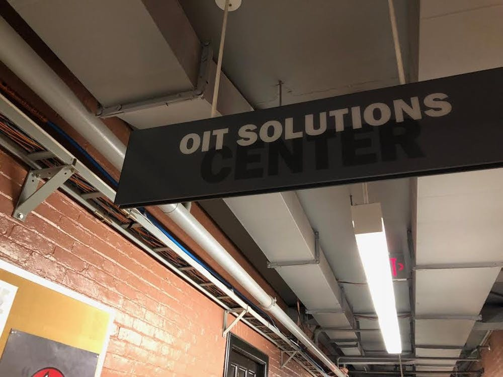 A sign for the OIT Solutions Center hangs in the 100 level of the University's Frist Center.