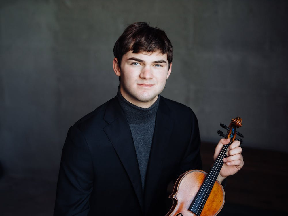 Nathan Meltzer and his violin. Jiyang Chen for The Daily Princetonian