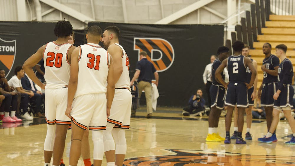 The Tigers huddle before starting the second half against Monmouth. Photo Credit: Tom Salotti / The Daily Princetonian