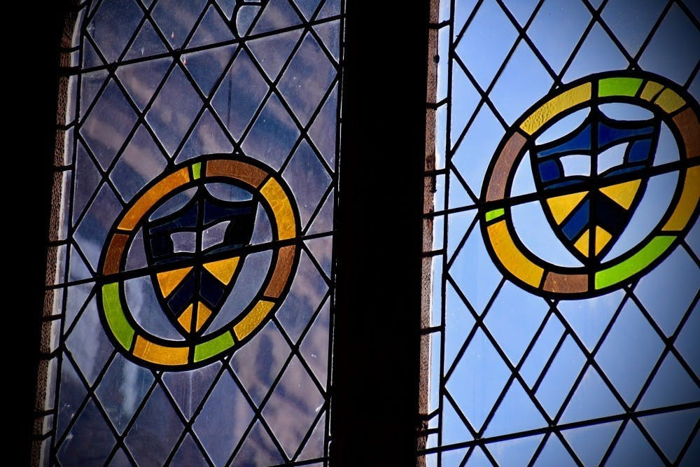 <h5>Stained glass windows in East Pyne Hall, home of the Classics department.</h5> <h6>Jon Ort / The Daily Princetonian</h6>