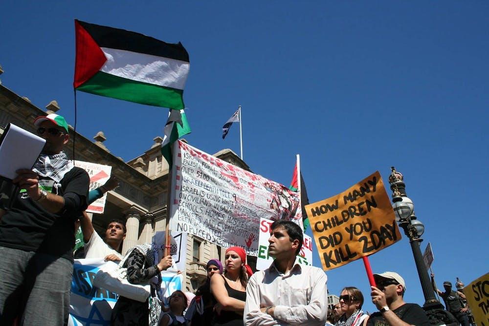"<h6>""Palestine Flag at Parliament House"" by John Englart / <a href=""https://www.flickr.com/photos/takver/3206662896"" target=""_self"">CC BY-SA 2.0</a></h6>"