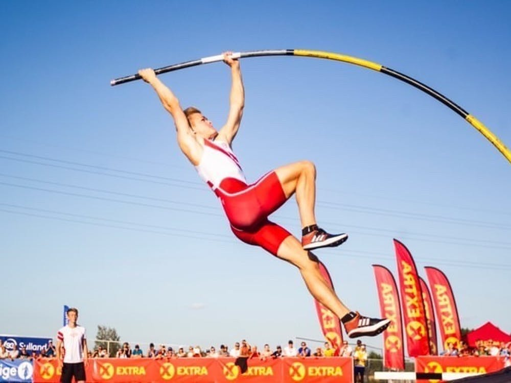 Sondre Guttormsen in the air during a pole vault competition.  Courtesy of Kristin Guttormsen.