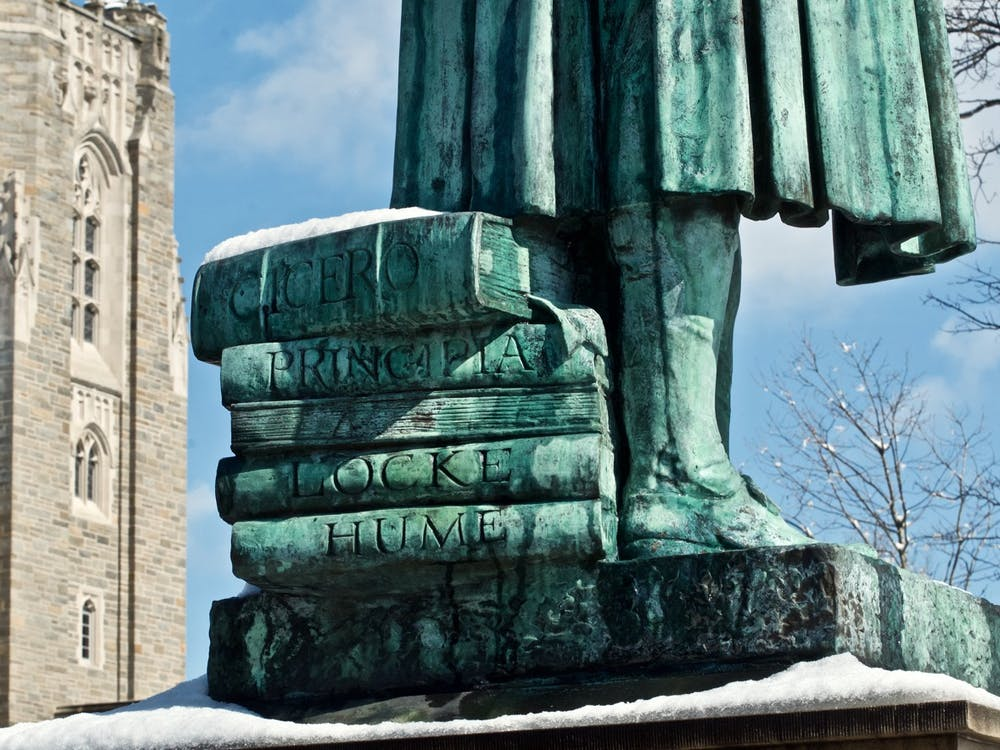 A stack of books beneath the feet of the John Witherspoon statue near Firestone Library. A recently-circulated list of anti-racist demands signed by over 350 faculty members calls for the statue's removal. Photo courtesy of © Richard Trenner '70