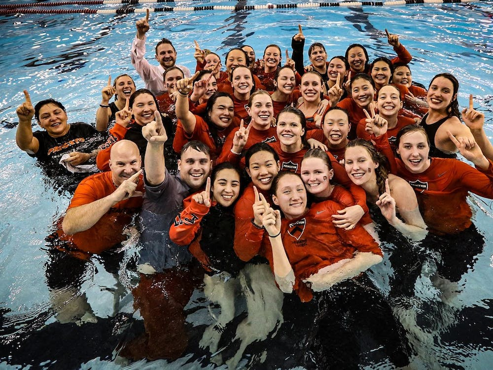 Caption: Women's swimming and diving participating in the Ivy League champion tradition: jumping into the pool as a team.  Credit: The Ivy League