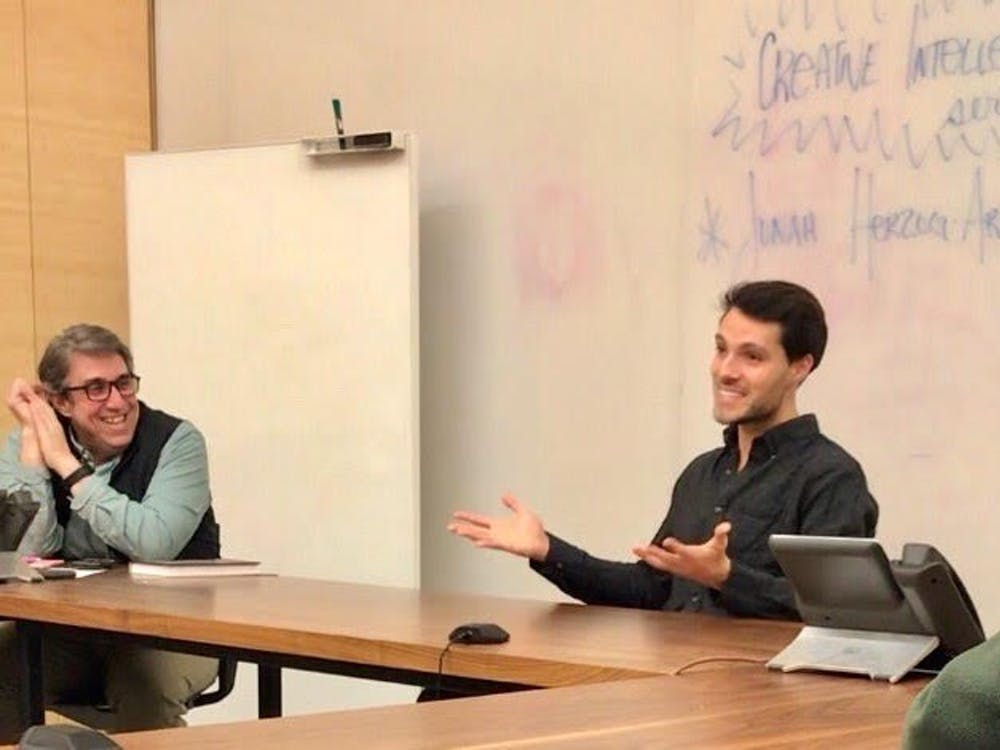 Jonah Herzog-Arbeitman '19 and associate theater professor Brian Herrera on Thursday, Dec. 13.