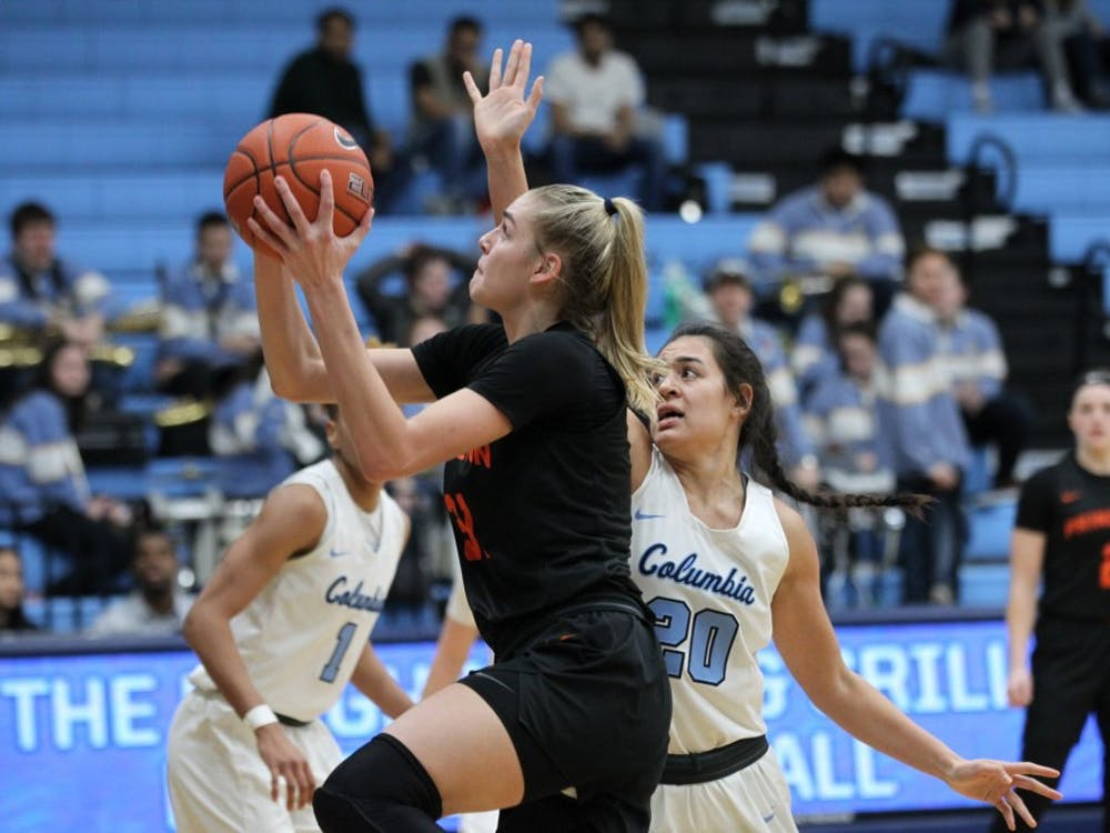 Bella Alarie goes up for a layup against Columbia