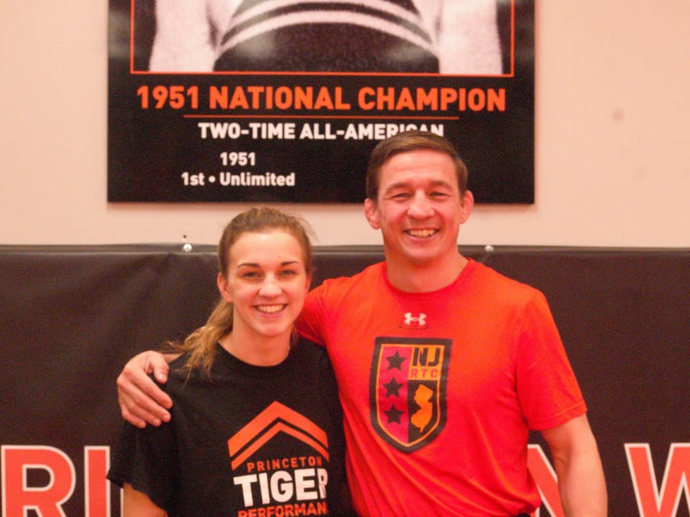 Head coach Christopher Ayres and Demetra Yancopoulos. Photo Credit: Josephine de La Bruyere / The Daily Princetonian