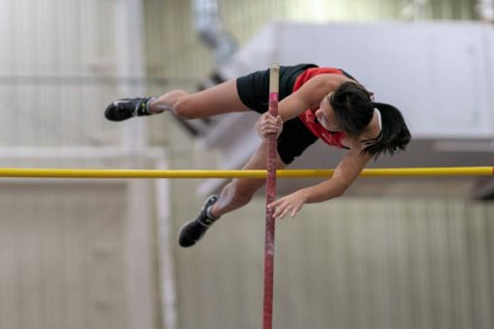 <h5>Cohen clearing the bar during a pole vault competition.</h5> <h6>Courtesy of Germantown Academy</h6>