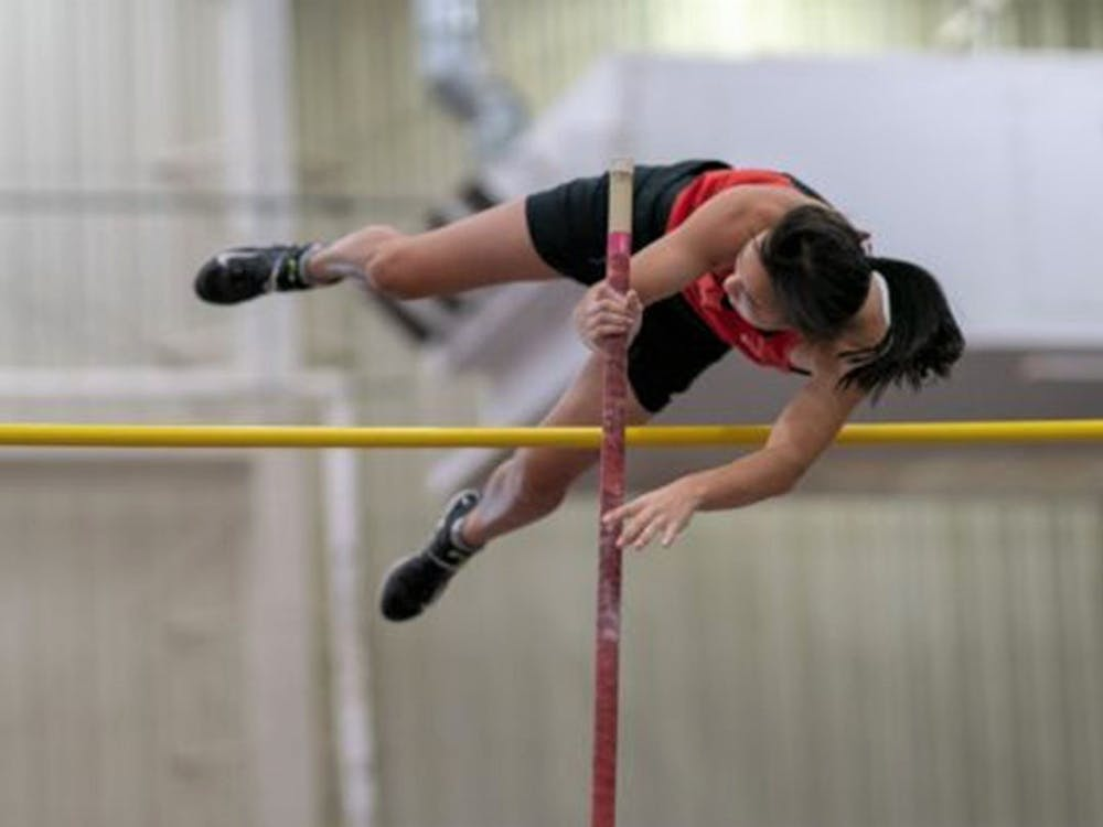 Cohen clearing the bar during a pole vault competition. Courtesy of Germantown Academy