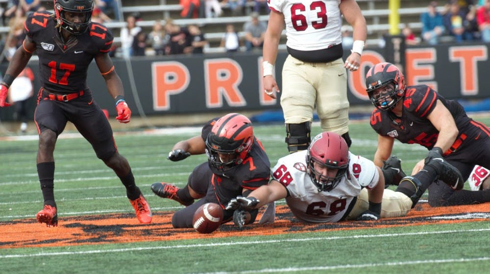Princeton and Harvard players fight for a loose ball. Photo Credit: Jack Graham / The Daily Princetonian.