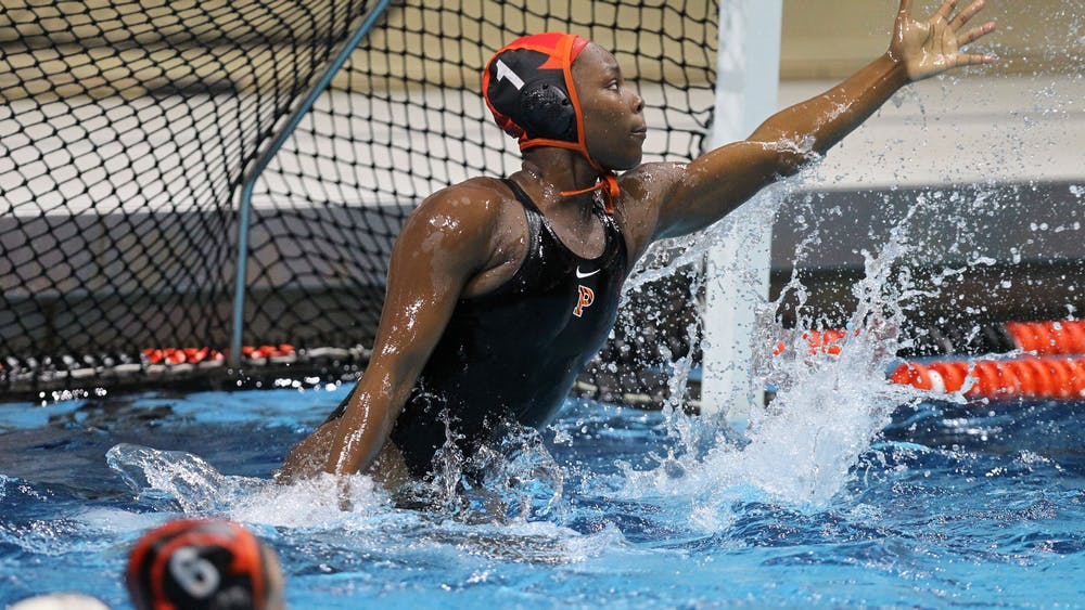 """<h5>Ashleigh Johnson '17 playing water polo during her time at Princeton</h5> <h6>Beverly Schaefer / <a href=""""https://goprincetontigers.com"""" target=""""_self"""">GoPrincetonTigers.com</a></h6>"""