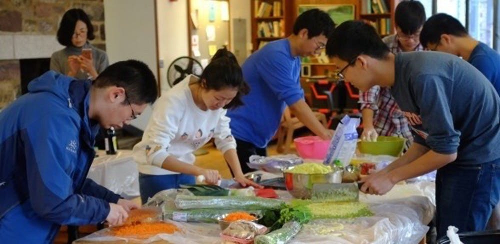 Students cooking at an event with Princeton's Association of Chinese Students and Scholars. Courtesy of ACSSPU.