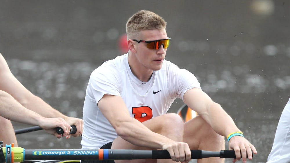 """<h5>Tom George '18 rowing for Princeton in 2017.</h5> <h6>Courtesy of Beverly Schaefer / <a href=""""https://goprincetontigers.com"""" target=""""_self"""">GoPrincetonTigers.com</a></h6>"""