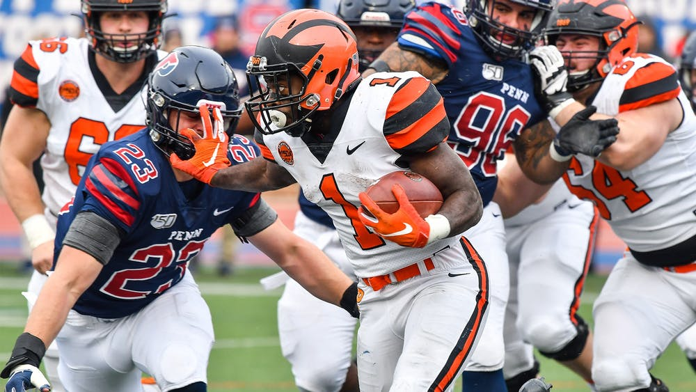 Caption: Eaddy running the ball against UPenn  Credit: Beverly Schaefer, goprincetontigers.com