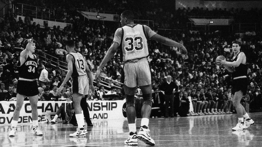 Bob Scrabis '89 (#34) and Kit Mueller '91 (#00) orchestrate the offense in Princeton's 1989 NCAA tournament game against Alonzo Mourning (#33) and the Georgetown Hoyas. Courtesy of GoPrincetonTigers.com.