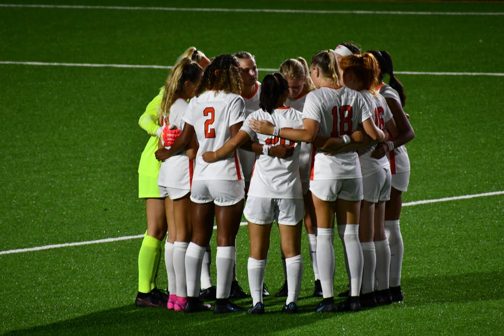 <h5>The women's soccer team meets in a quick circle before starting the second half of their game against Yale Saturday night. The score was still 0–0 at this point.</h5> <h6>Natalia Maidique / The Daily Princetonian</h6>