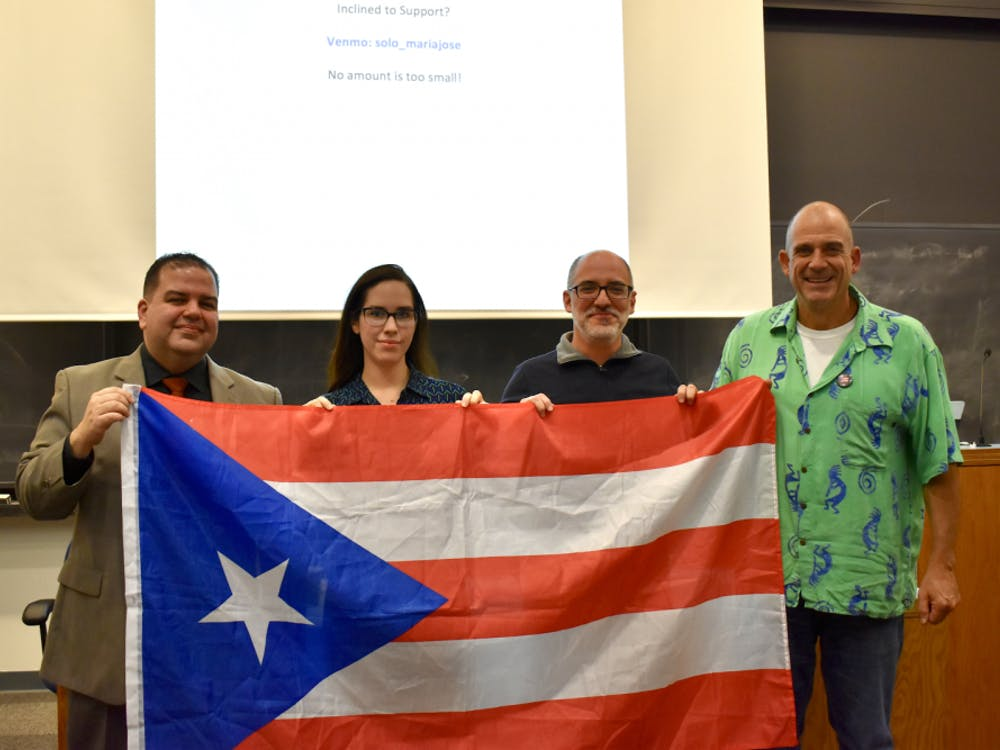 A panel held in Lewis Library on Friday, Nov. 16 at 4:30 p.m. spoke on the aftermath of Hurricane Maria. From left to right: Jose Pabon '19, Writing Program lecturer Dannelle Gutarra Cordero, Latin American Studies Librarian Fernando Acosta-Rodriguez, and computer science lecturer Alan Kaplan. Photo courtesy of Maria Jose Solorzano '20.