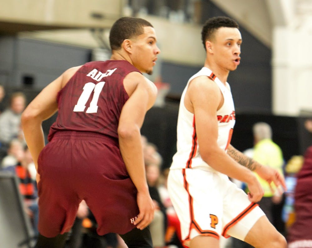 Bryce Aiken defends Jaelin Llewellyn in the first half of Harvard's win