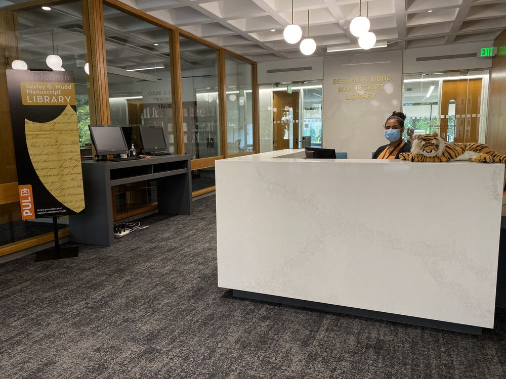 <h5>Public Services Archivist Amanda Ferrara in the newly renovated lobby of the Mudd Library.&nbsp;</h5> <h6><strong>Brandon Johnson</strong> / Princeton University Library</h6>