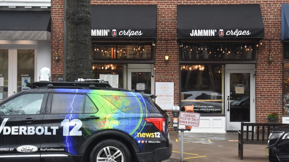 A news truck sits outside Jammin' Crepes shortly after Gov. Murphy signed a piece of legislation inside.  Mark Dodici / The Daily Princetonian