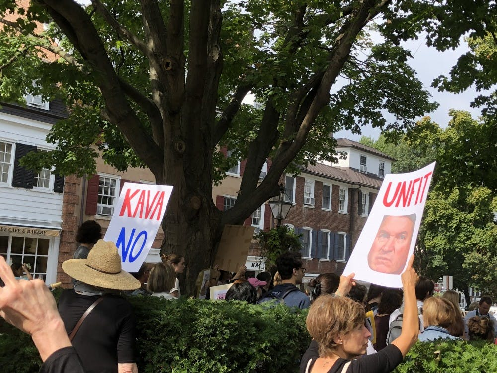 """On Oct. 4, protestors hold signs opposing Kavanaugh during the """"Emergency Rally"""" in Tiger Park."""